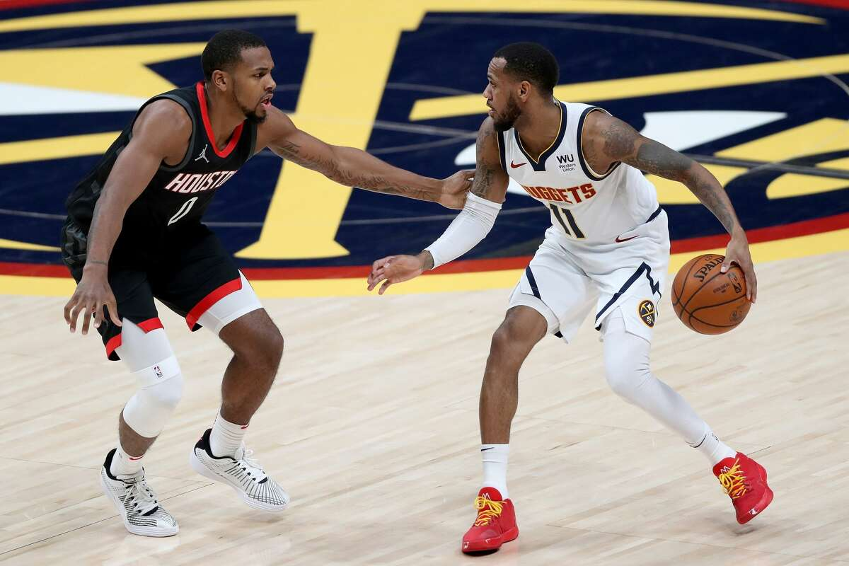 DENVER, COLORADO - DECEMBER 28: Monte Morris #11 of the Denver Nuggets drives against Sterling Brown #0 the Houston Rockets in the second quarter at Ball Arena on December 28, 2020 in Denver, Colorado. (Photo by Matthew Stockman/Getty Images)