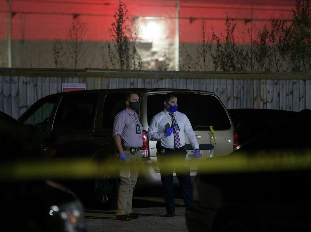 Houston Police officers and homicide detectives investigate the scene where the deceased body of a 15-year-old male was found, on the 8000 block of Cook Road on Monday, Dec. 28, 2020, in Houston.