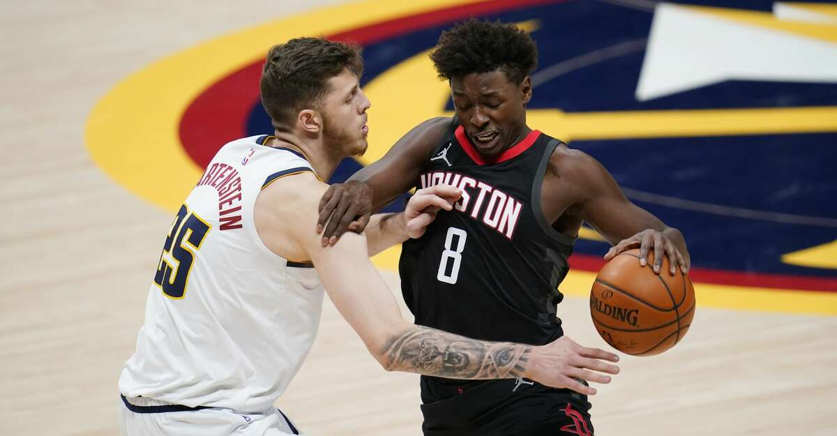 Denver Nuggets center Isaiah Hartenstein, left, fouls Houston Rockets forward Jae'Sean Tate during the second half of an NBA basketball game Monday, Dec. 28, 2020, in Denver. The Nuggets won 124-111. (AP Photo/David Zalubowski)