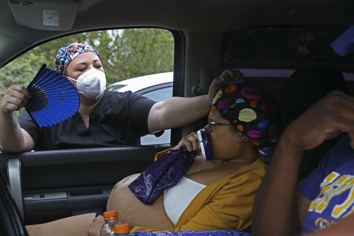 Childbirth doula Kristi Dixon Pride, left, comforts Candice Phillips as they arrive at San Antonio Nurse Midwife Birth and Wellness Center, Thursday, Oct. 15, 2020. Hours later, Phillips delivered a 7 pounds, 6 ounces baby girl named Kristian.