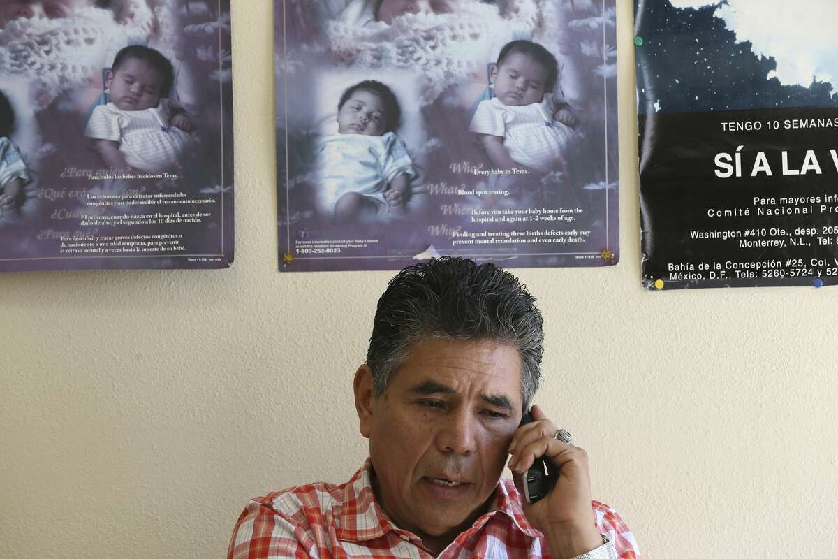 Licensed midwife Ruben Casillas takes a call from a prospective client at his Maternidad Laredo Clinic, in Laredo, Texas, Wednesday, March 11, 2020. The clinic offers natural and water births for clients mostly from Laredo and Nuevo Laredo, Mexico.