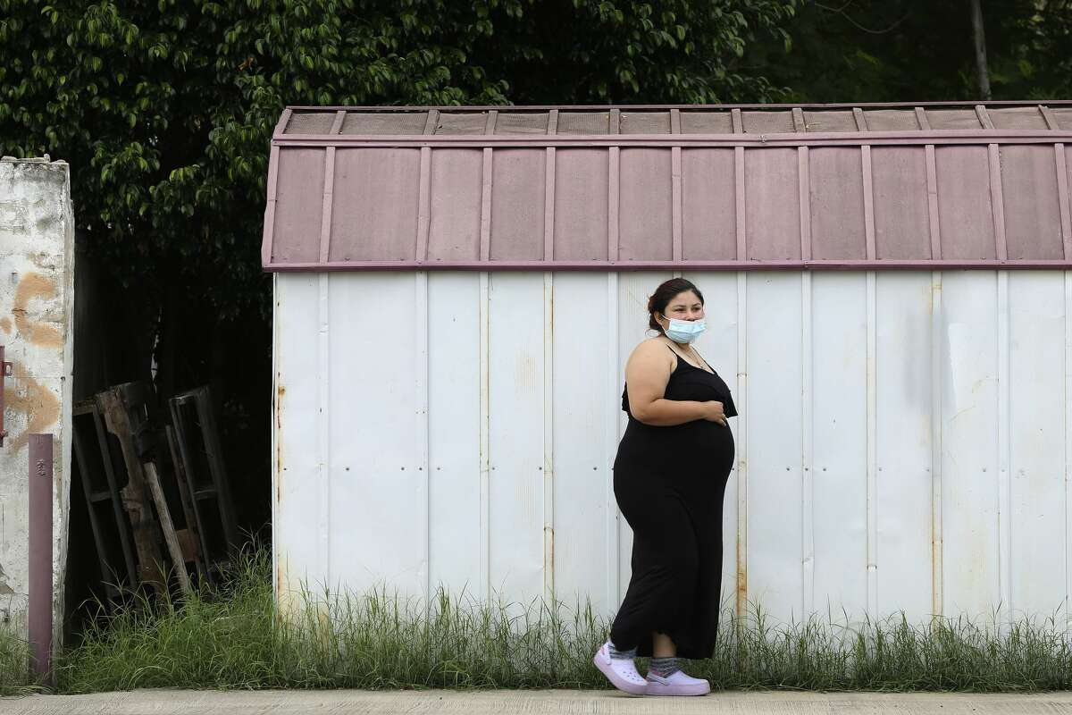 Arleth Garcia, 24, walks around the parking lot of the Maternidad Laredo clinic to help in the birthing her daughter in Laredo, Texas, Monday, Sept. 21, 2020. Garcia was at the clinic under the care of licensed midwife, Ruben Casillas. He opened the clinic in 2003 and is the only midwife in Laredo. Garcia went on to birth at 7:59 that evening.