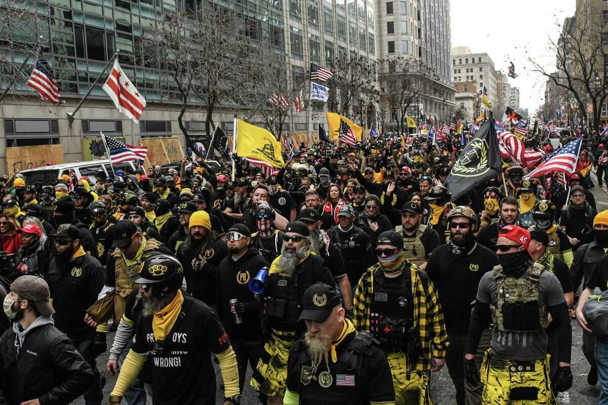 Members of the Proud Boys march toward Freedom Plaza during a protest on Dec. 12 in Washington, D.C. Thousands of protesters who refuse to accept that President-elect Joe Biden won the election are rallying ahead of the electoral college vote to make Trump's 306-to-232 loss official.