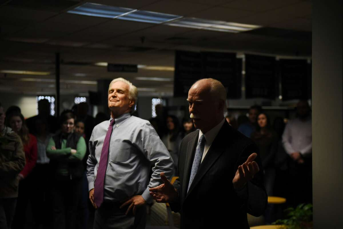 Times Union publisher George R. Hearst III, right, thanks Rex Smith, left, for his service to the paper during an announcement where he named Casey Seiler as editor and vice president of the Times Union on Tuesday, Jan. 21, 2020, at the Times Union in Colonie, N.Y. Smith will continue as editor-at-large. (Will Waldron/Times Union)