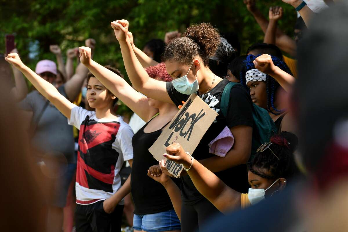 Arms are raised in a show of solidarity during a Black Lives Matter rally on June 5, 2020, held at Crandall Park in Glens Falls. More than 2,000 demonstrators marched down Glen Street to the park.