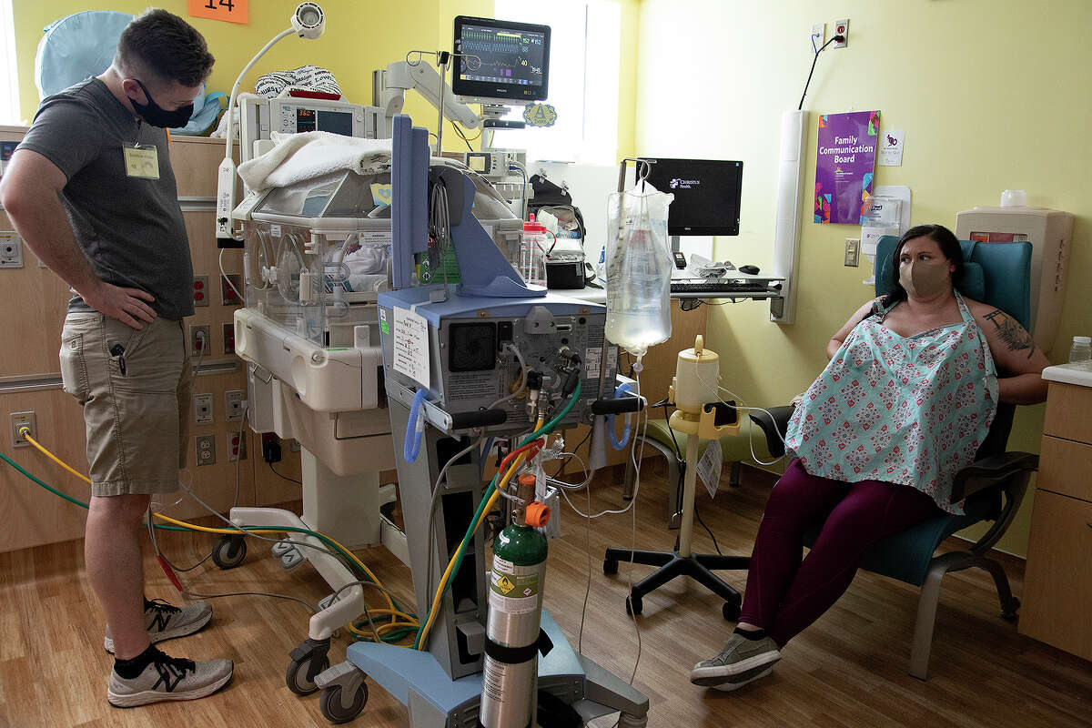 Alysia Ford pumps breast milk while Colton Ford looks at their son, Draconius Ford, in his isolette in the neonatal intensive care unit at The ChildrenÃ?•s Hospital of San Antonio on Sept. 3, 2020.