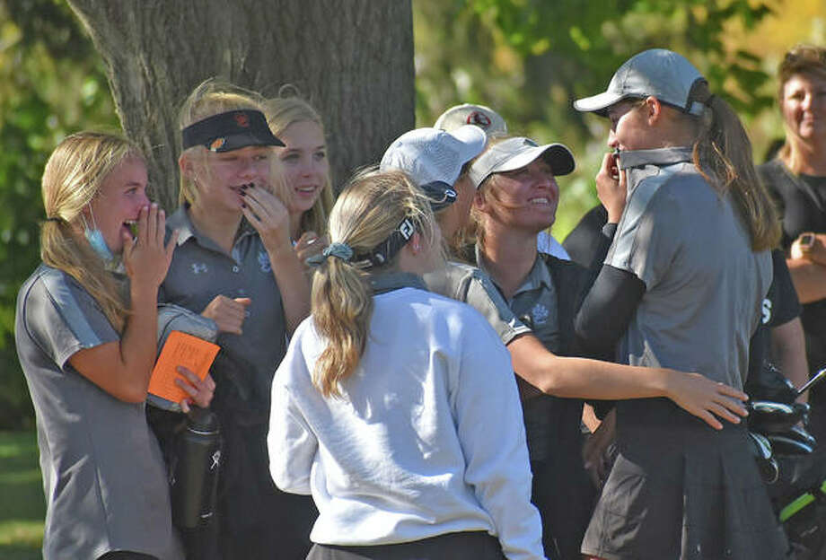 Edwardsville sophomore Nicole Johnson, right, is congratulated by her teammates after winning medalist honors at the Class 2A Champaign Centennial Sectional at the University of Illinois Golf Course in Savoy. Photo: Matt Kamp|The Intelligencer