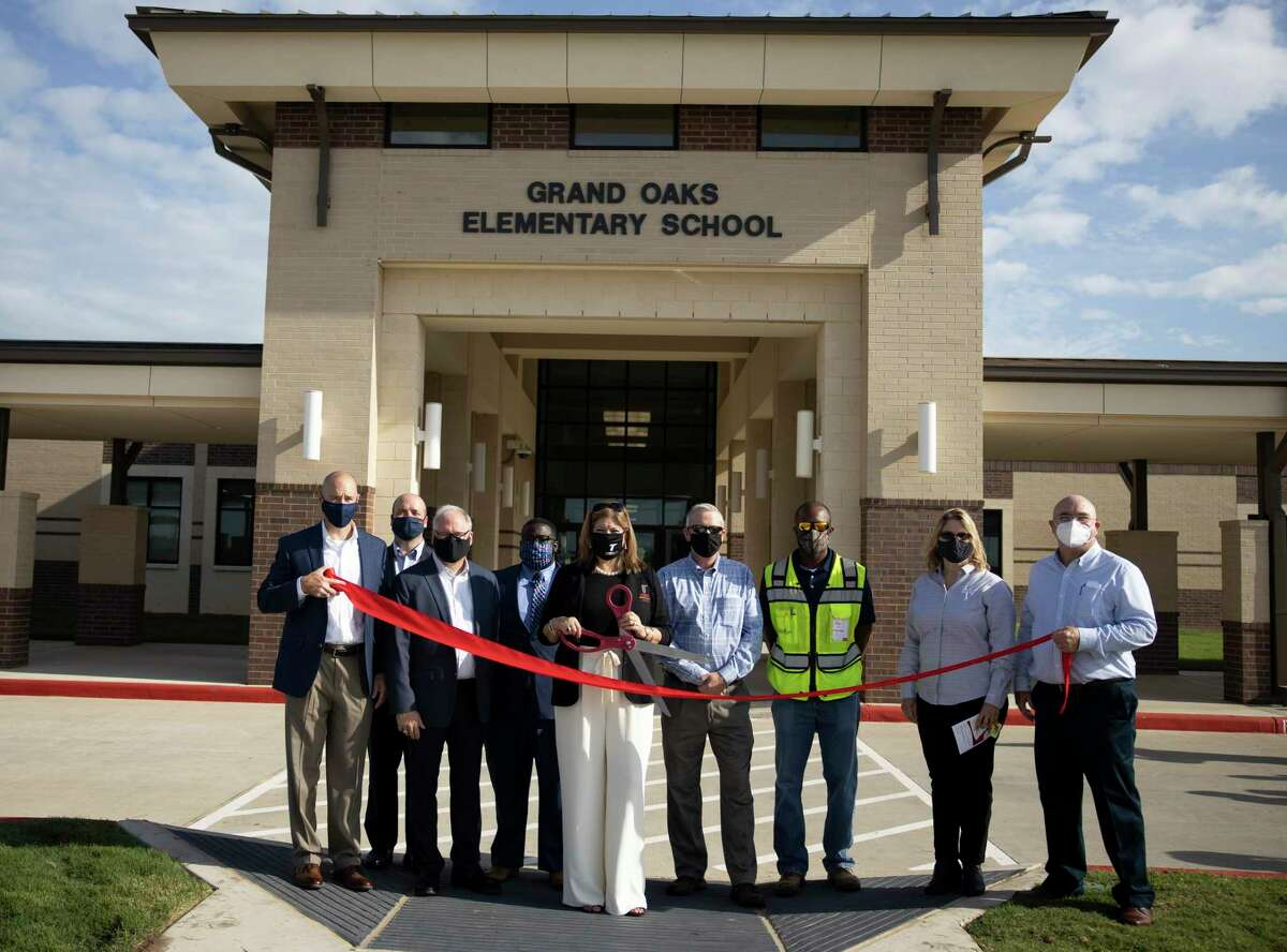 The construction team along with Tomball ISD superintendent Dr. Martha Salazar-Zamora pose for a portrait during a ribbon cutting held at Grand Oaks Elementary in Tomball, Friday, Sept. 4, 2020. The facility was funded through the Tomball ISD's Bond 2017.
