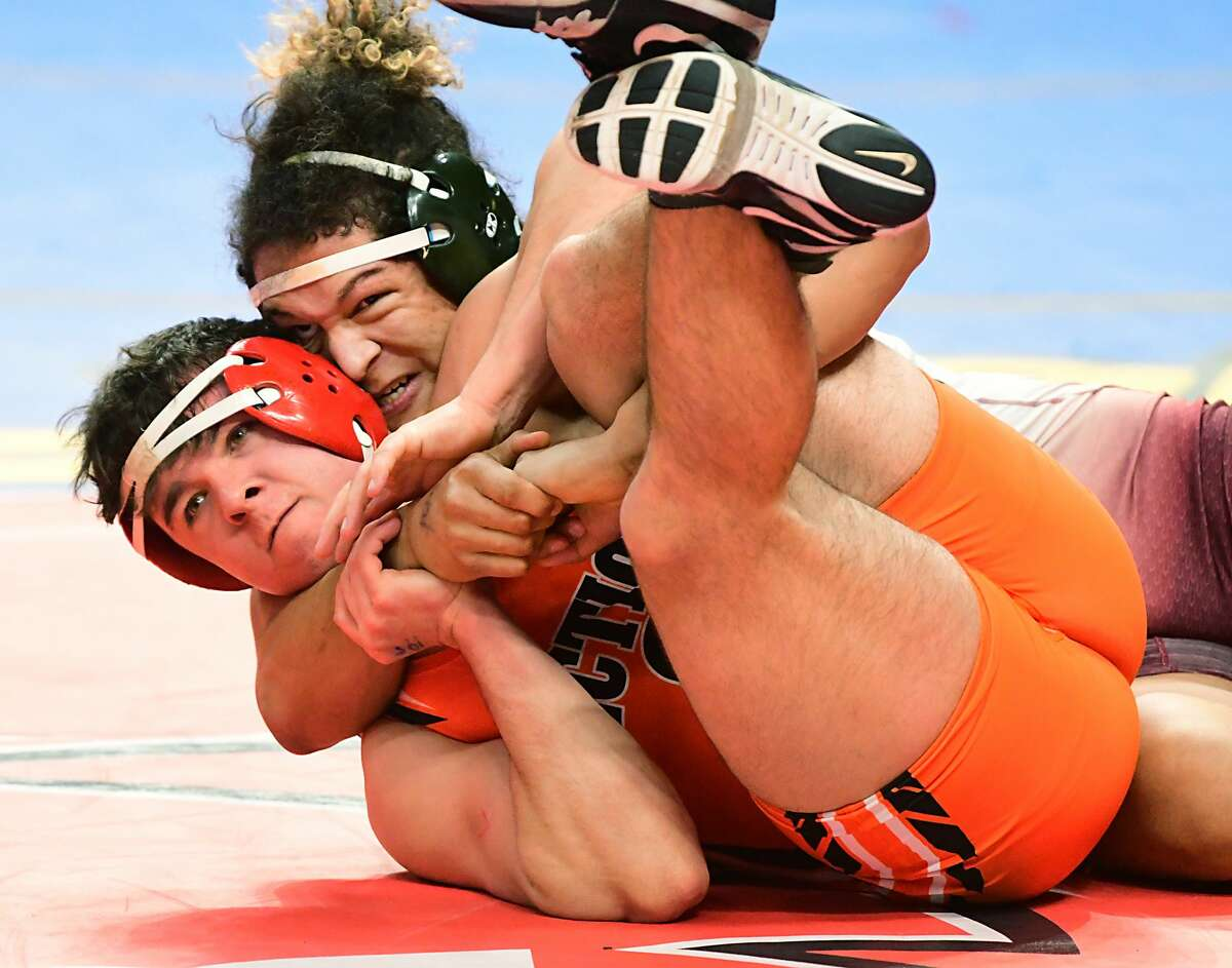 Guilderland's Cameron Durant, top, competes with Lancaster's Codie Scotland in the 195 lb weight class for Div. l during the State Wrestling Championships at the Times Union Center on Friday, Feb. 28, 2020 in Albany, N.Y. (Lori Van Buren/Times Union)