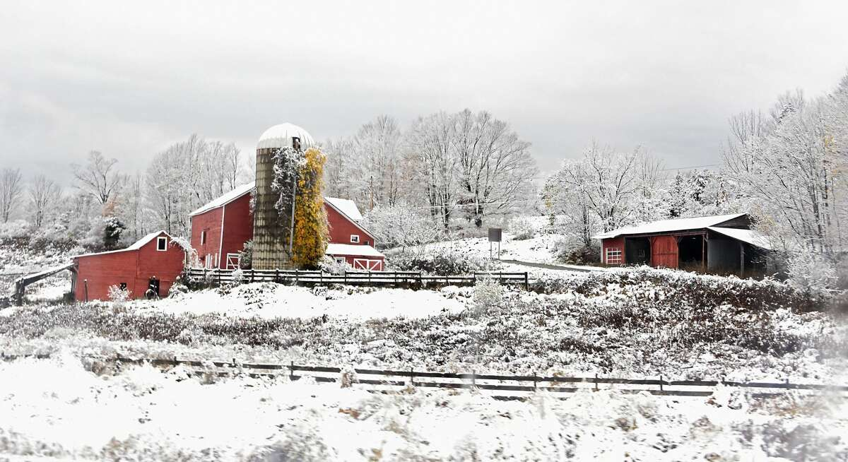 The National Weather Service in Albany says light snow will hit part of the area on Monday. In this photography, acolorful farm stands out in a wintery scene after the Capital Region received its first snow fall of the season on Friday, Oct. 30, 2020 in Claverack.(Lori Van Buren/Times Union)