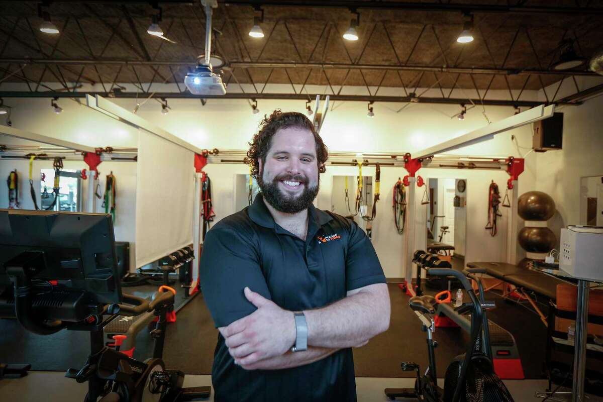 Pledge to Fitness owner, Andres Loperena poses for a photo in his boutique gym Friday, Dec. 18, 2020, in Houston.