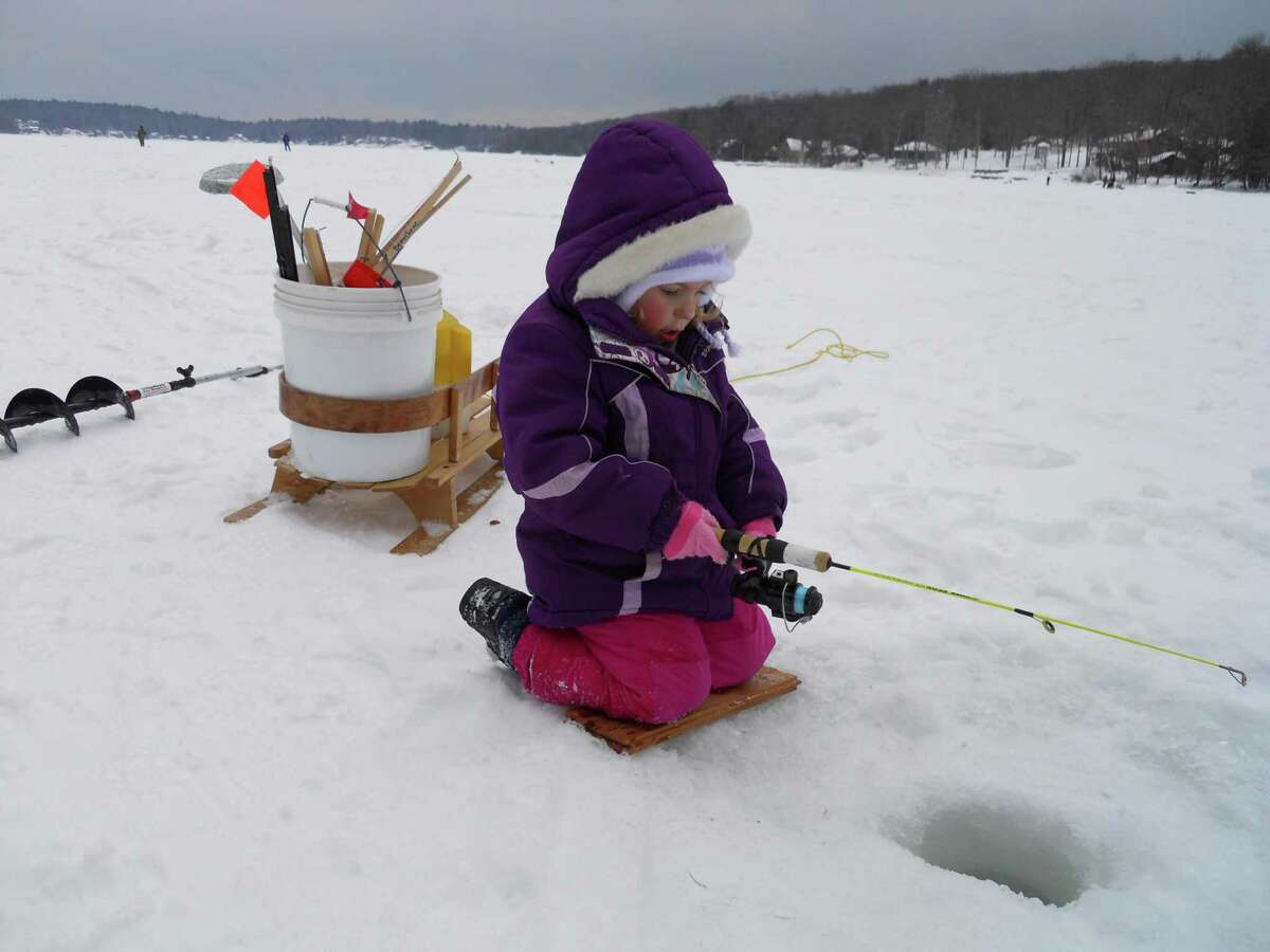 Katherine Beauchene, of Barkhamsted, waits to see if the fish are biting on West Hill Pond in Barkhamsted.