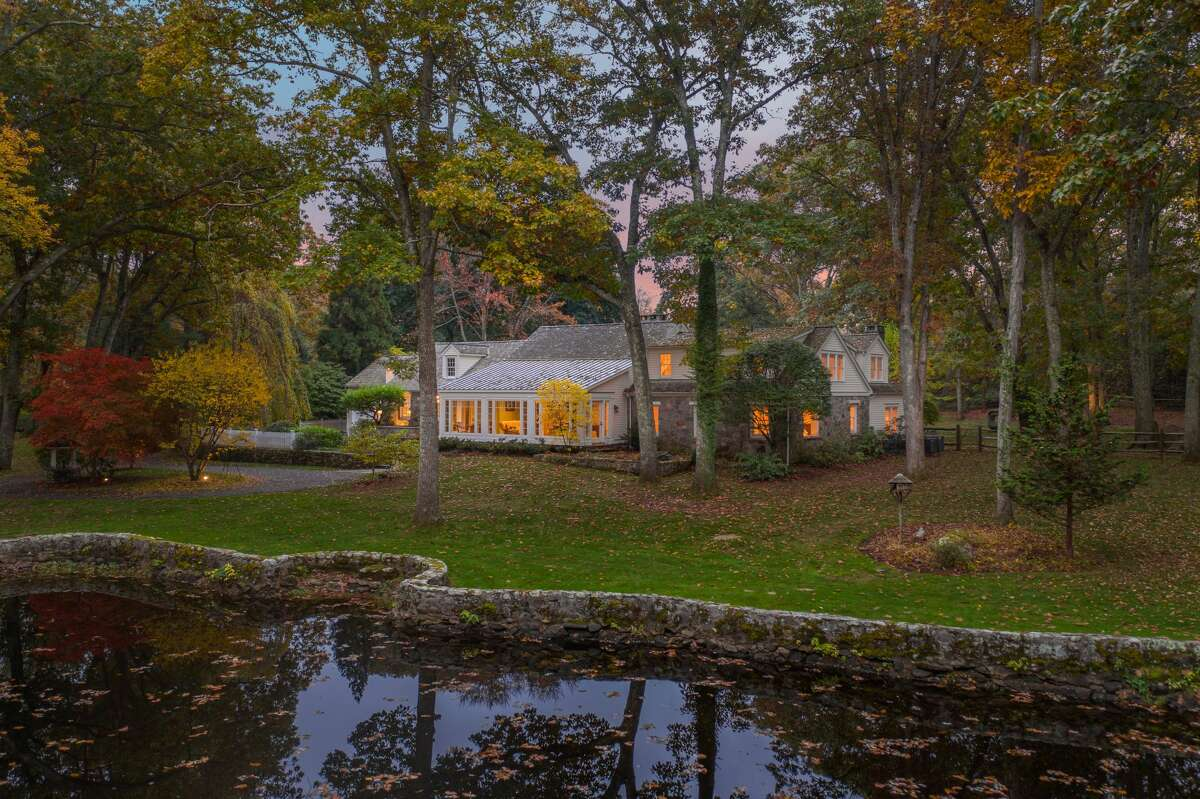 From this property at 232 Newtown Turnpike, Weston residents can canoe to a large pond.