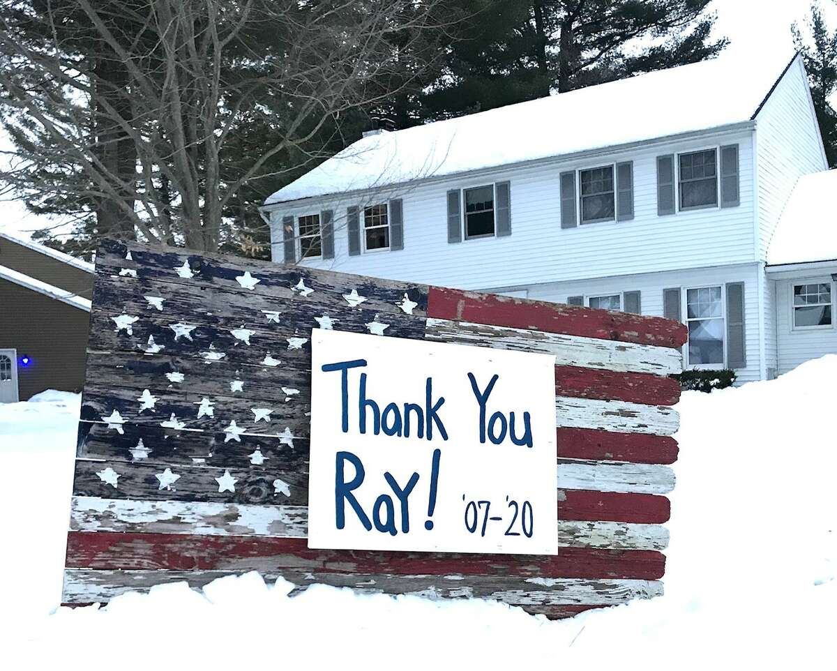 Dozens of customers along Ray Andi's mail route made homemade signs to thank him for his terrific mail service for the past 16 years in Guilderland (Paul Grondahl / Times Union)