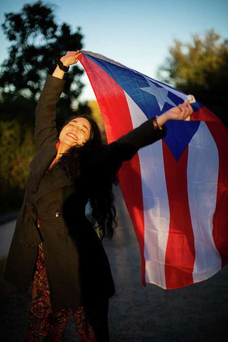 Houston-based poet Miriam Maldonado, 39, shows pride in her Puerto Rican heritage at Eleanor Tinsley Park. Now that she has recovered from COVID-19, she plans to spend Día de Reyes, or Three Kings Day, with her children in San Marcos. Photo: Marie D. De Jesús, Houston Chronicle / Staff Photographer / © 2020 Houston Chronicle