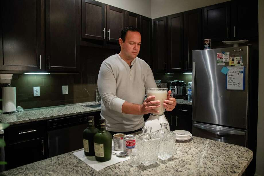 """Univision reporter José Irizarry prepares coquito. Coquito, which means """"little coconut"""" in Spanish, is a traditional Christmas drink that originated in Puerto Rico. Photo: Marie D. De Jesús, Houston Chronicle / Staff Photographer / © 2020 Houston Chronicle"""