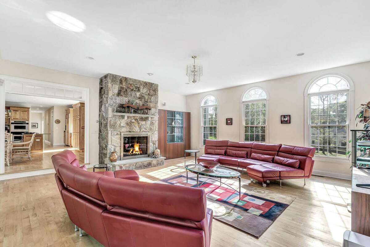 Family room with custom stone fireplace at 166 Wells Hill Road, Easton.