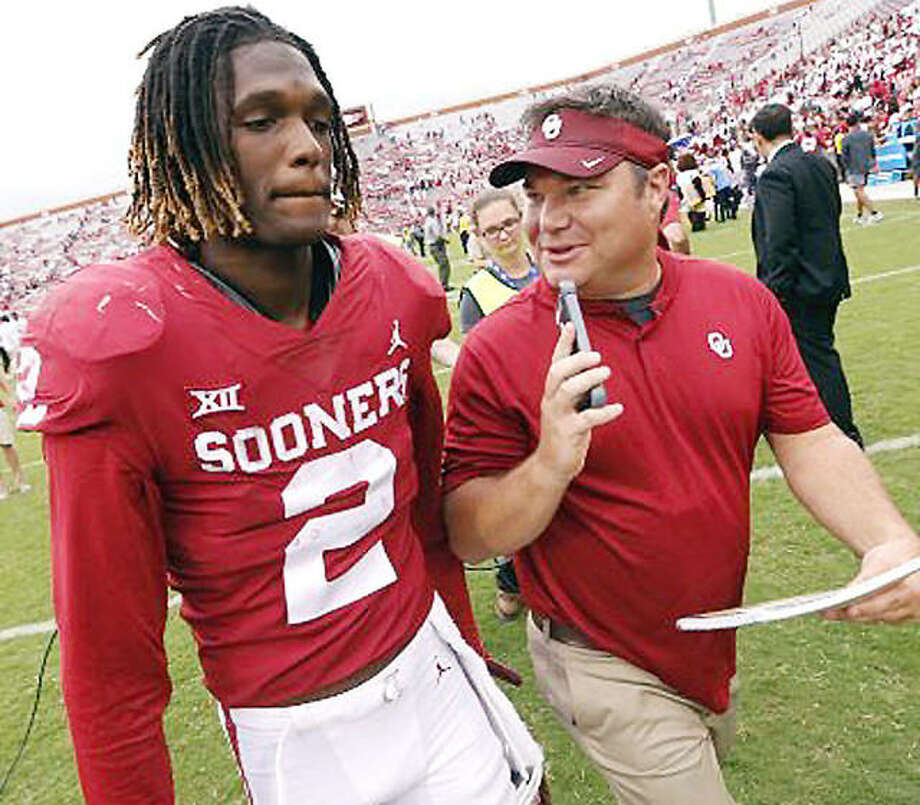 Wood River native Chris Plank, right, interviews Sooners player Theo Howard following a game. Plank is the sideline reporter for OU football games, but will make his college football play-by-play debut at Wednesday's Cotton Bowl game between Oklahoma and Florida. Photo: Oklahoma Athletics