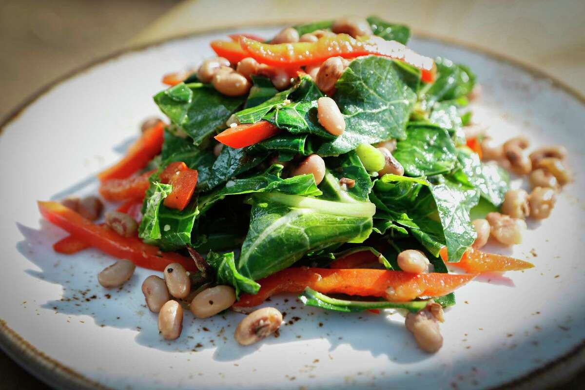 Chef Chris Williams' sauteed collards at Lucille's, 5512 La Branch St., Friday, Dec. 18, 2020, in Houston.