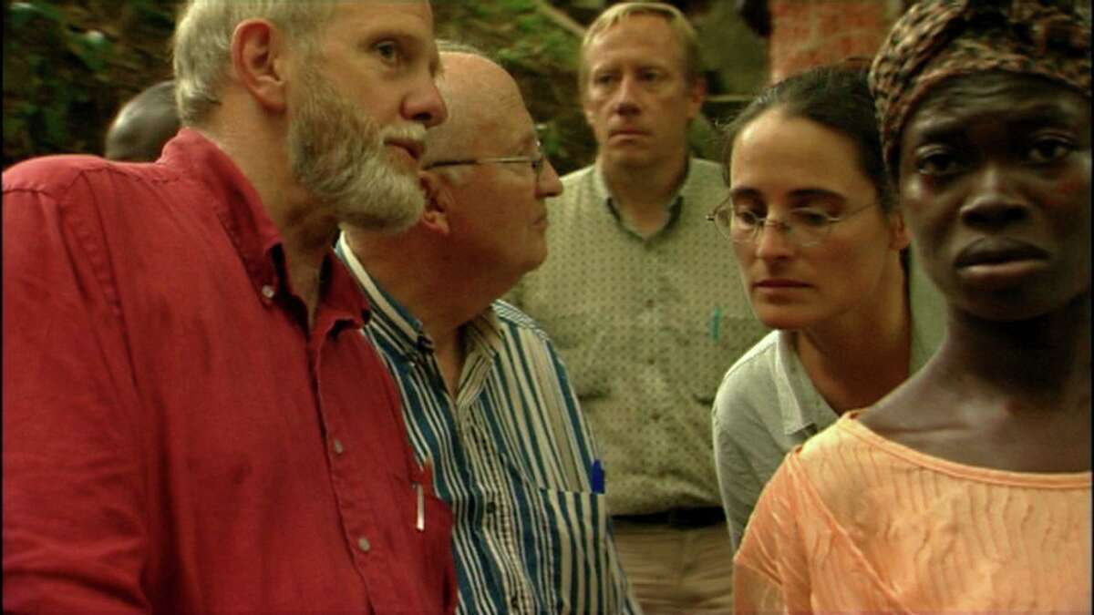 """""""Traces of the Trade,"""" an award-winning documentary about New England's hidden connection to slavery, will be screened as part of an online event at Trinity Episcopal Church in Southport, Sunday, Jan. 10. It was produced/directed by Katrina Browne, whose Rhode Island ancestors, the DeWolfs, were the largest slave-trading family in U.S. history. DeWolf family members and Ghanaian Beatrice Manu are seen here at a river ceremony in Ghana where captured Africans were brought for a last bath."""