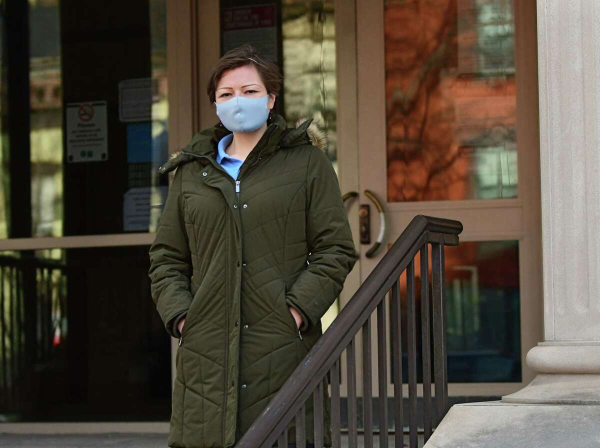 Catherine Duggan stands outside Albany County Family Court where she works on Tuesday, Dec. 29, 2020 in Albany, N.Y. Duggan is a cleaner who is employed by Second Chance Opportunities of Albany to keep the Albany County Family Court building clean and disinfected. (Lori Van Buren/Times Union)