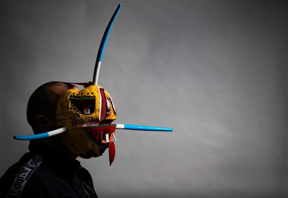 President of the Festival Puertorriqueño & Cubano, Javier Ferrer, 53, wears a vejigante mask. A vejigante is a folkloric character in Puerto Rican festival celebrations. Photo: Marie D. De Jesús/Staff Photographer / © 2020 Houston Chronicle