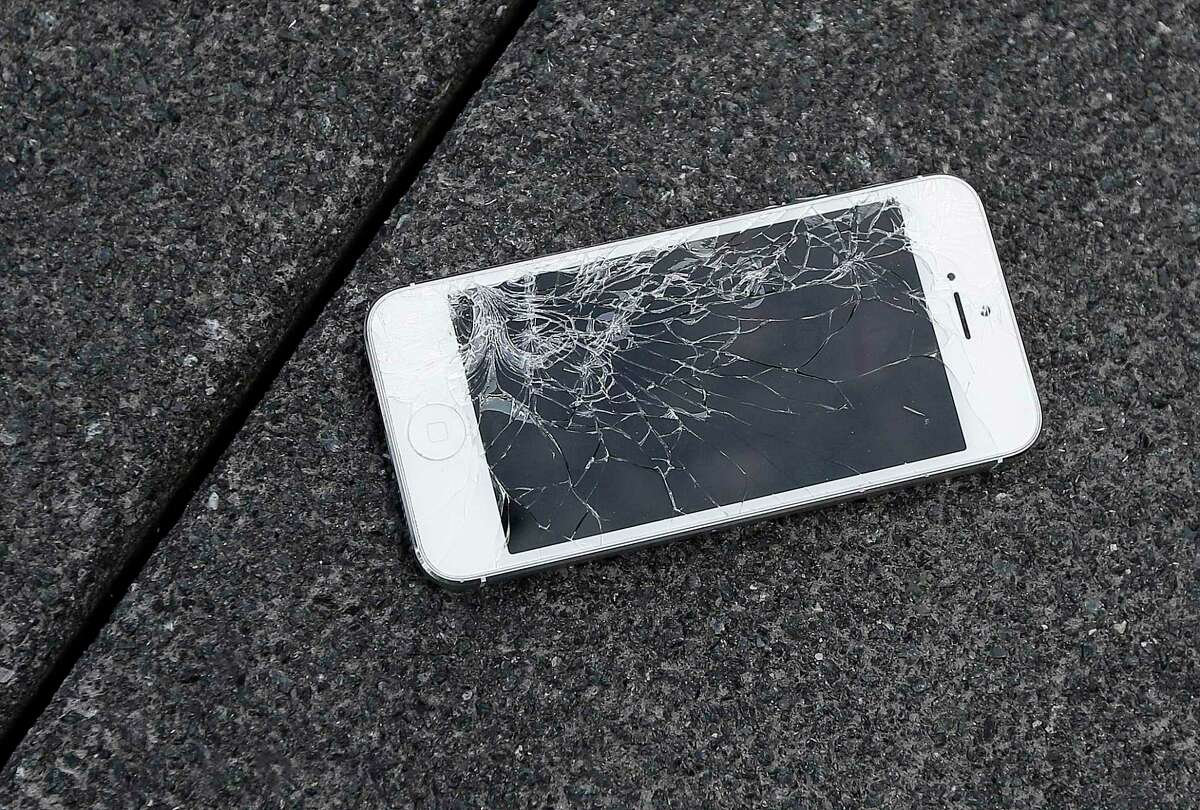 FILE - This Aug. 26, 2015 photo shows an Apple iPhone with a cracked screen after a drop test from the DropBot, a robot used to measure the sustainability of a phone to dropping, at the offices of SquareTrade in San Francisco. Apple said Thursday, Aug. 29, 2019, that it will sell tools and parts to independent phone-repair shops in the U.S. and later in other countries. The repair shops need to have an Apple-certified technician. Repairs at these shops, though, will be limited to products already out of warranty. (AP Photo/Ben Margot, File)
