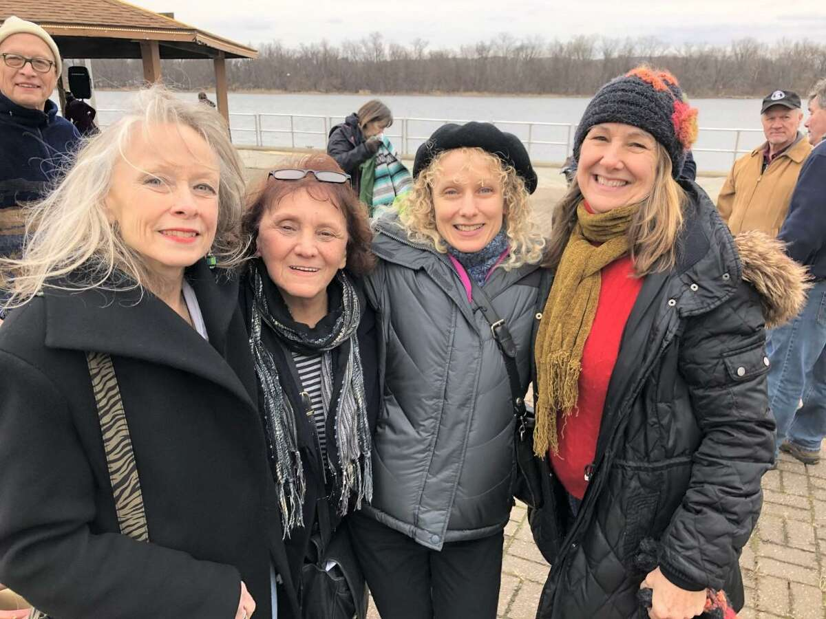 Anne-Marie Cannata McEwan, at far right, is the executive director of The Buttonwood Tree in Middletown. The group is shown at last year's Fire of Hope celebration, which was held at Harbor Park near the Connecticut River.