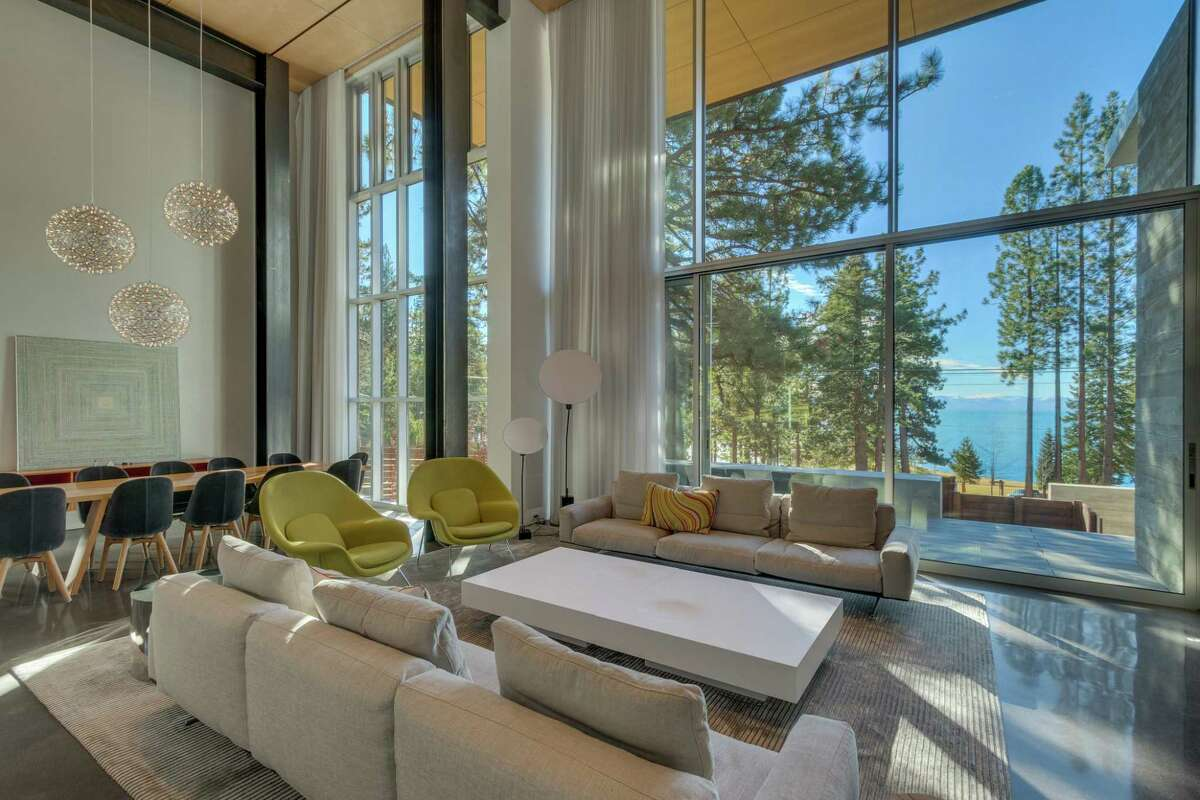 Floor-to-ceiling windows look out at the woodland surrounding and Lake Tahoe in the distance.