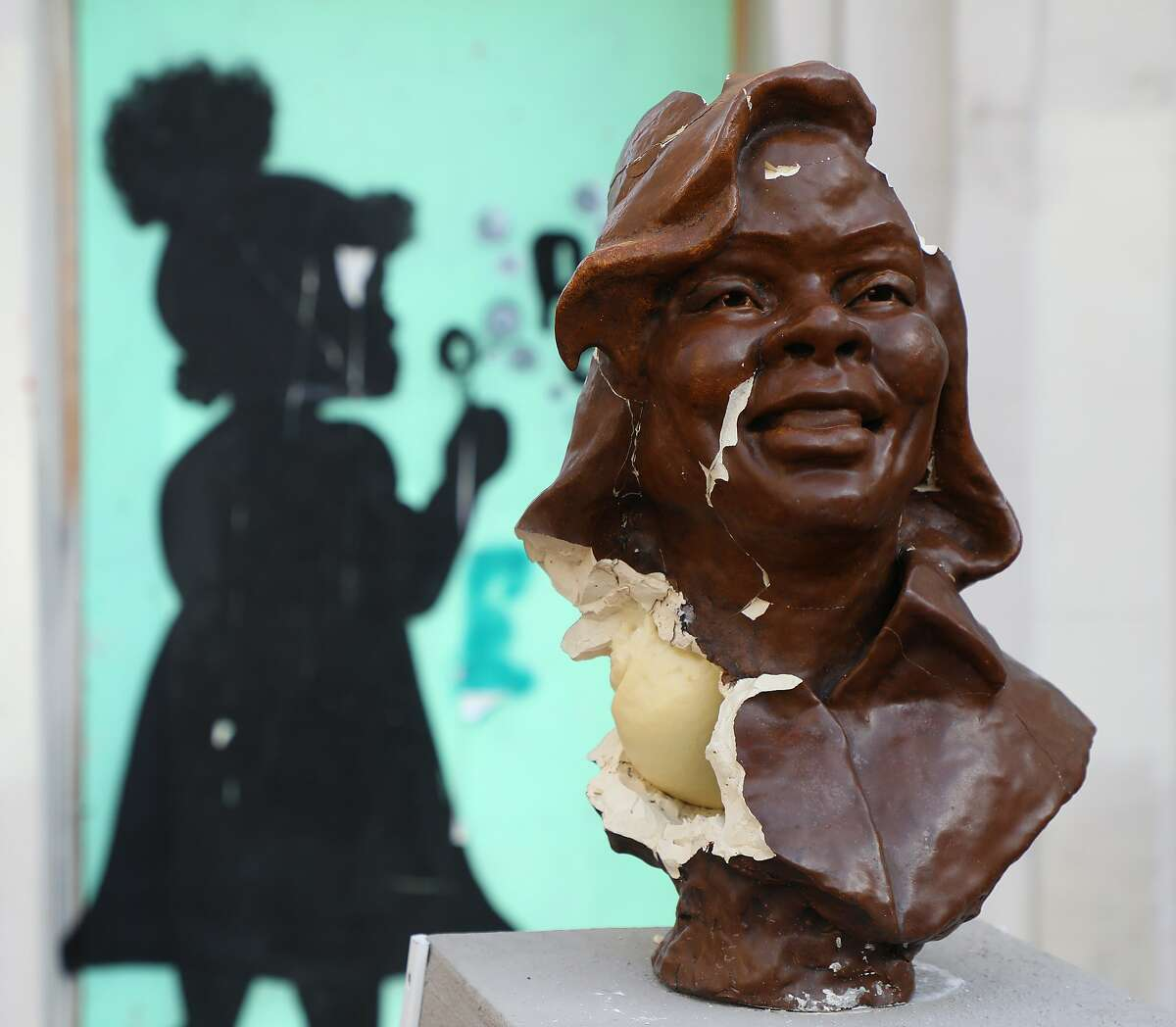 A broken bust of Breonna Taylor is shown on Sunday, Dec. 27, 2020, in Oakland. Police are investigating after the sculpture of Breonna Taylor was smashed to pieces in downtown Oakland over the weekend, authorities said.