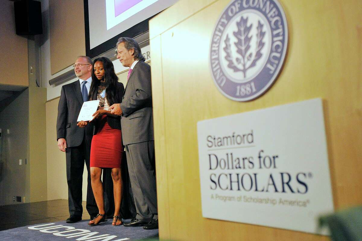 In June 2014, Asia Currie, center, is awarded a Stamford Dollars for Scholars scholarship by then-co-presidents Jim McClafferty, left, and Tony D'Amelio during its third annual scholarships awards ceremony at UConn Stamford.