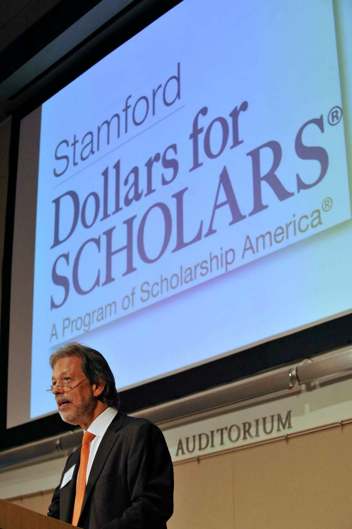 Stamford Dollars for Scholars co-president Tony D'Amelio gives the opening remarks during the organization's scholarship award ceremony at University of Connecticut's Stamford Campus on Monday, June 10, 2013.