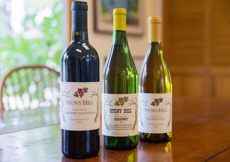 A 1978 Stony Hill Chardonnay, center, the first vintage bottle ever purchased from the winery by future owner Ted Hall, sits amongst new bottles of Stony Hill wine at Stony Hill Vineyard in Calistoga, Calif. Tuesday, Aug. 21, 2018.