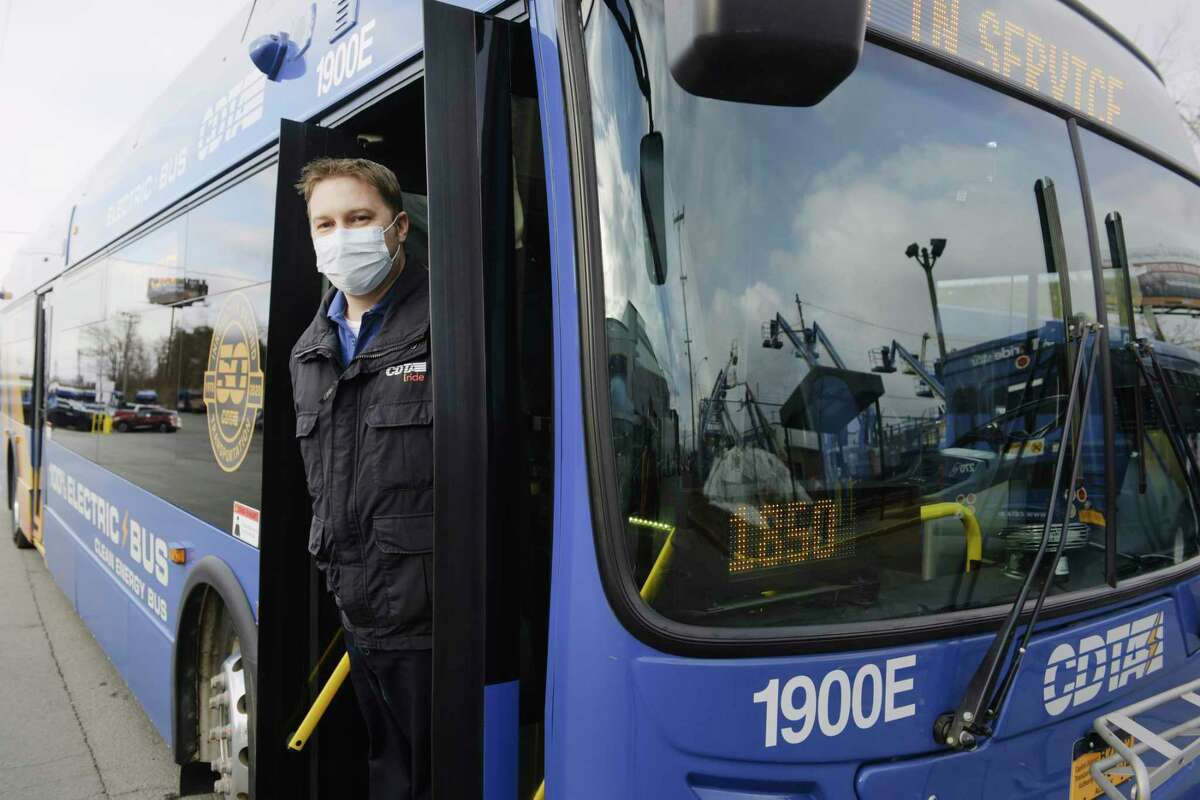CDTA bus driver Josh Richardsoutside the CDTA bus garage on Tuesday, Dec. 29, 2020, in Albany, N.Y. Richards has been driving a bus all through the COVID-19 pandemic. (Paul Buckowski/Times Union)