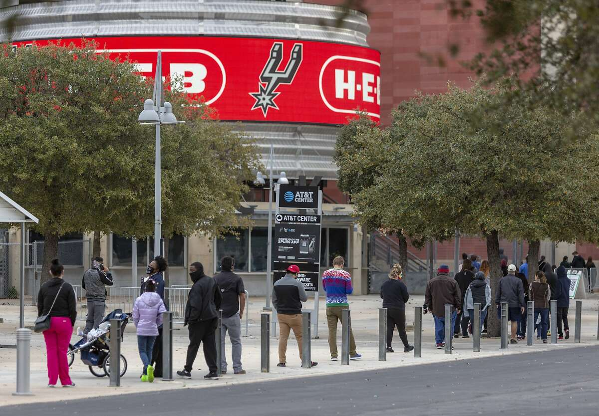 People waitin line outside the AT&T Center to get a COVID-19 coronavirus test on Dec. 29.