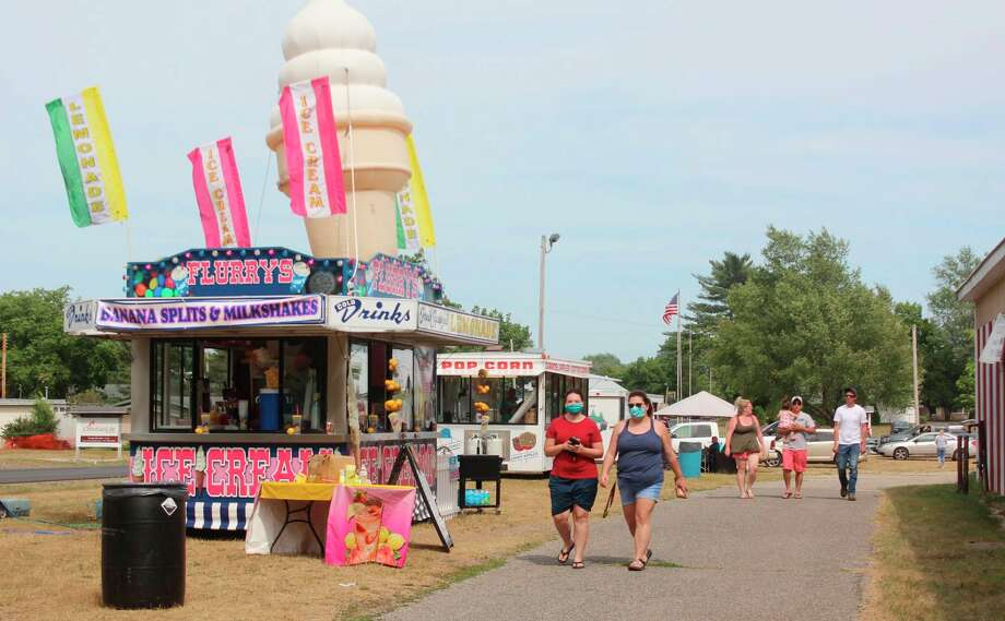 In this July 18, 2020 file photo, fair-lovers are pictured visiting the Mecosta County Fairgrounds to enjoy some classic fair food. For the first-time ever, this year's Mecosta County Free Fair was cancelled due to COVID-19. The fairgrounds hosted several food vendors to give the community an opportunity to somewhat enjoy the fair this year. (Pioneer file photo)