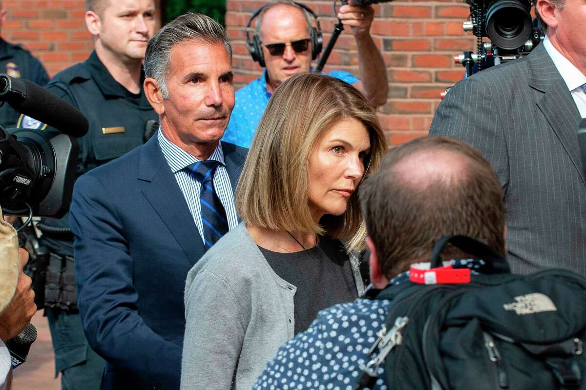 In this file photo, actress Lori Loughlin and husband Mossimo Giannulli exit the Boston Federal Courthouse after a pre-trial hearing with Magistrate Judge Kelley at the John Joseph Moakley US Courthouse in Boston on August 27, 2019. After serving two months, Loughlin was released from prison.