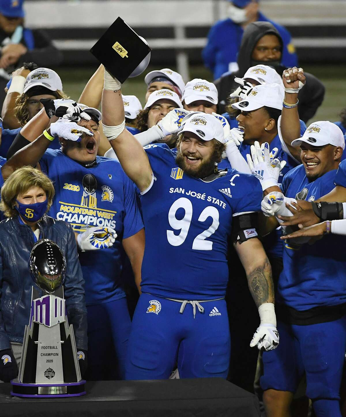 LAS VEGAS, NEVADA - DECEMBER 19: Defensive lineman Cade Hall #92 of the San Jose State Spartans lifts up the the Mountain West Championship game defensive MVP trophy after the team defeated the Boise State Broncos 34-20 to win the Mountain West Football Championship at Sam Boyd Stadium on December 19, 2020 in Las Vegas, Nevada. (Photo by Ethan Miller/Getty Images)