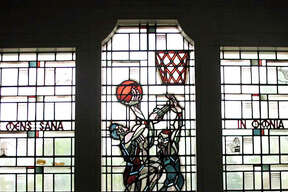 The stained glass window depicting basketball players at the old Trout Gym in Centralia used to greet basketball fans who traveled to the annual Christmas tournament there. It was installed when the gym was built in 1936.