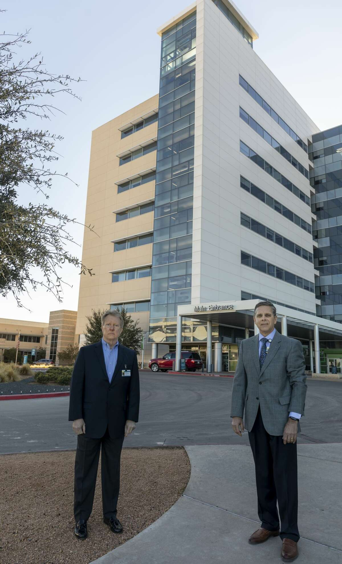 Dr. Larry Wilson, Midland Health chief medical officer, and President and CEO Russell Meyers stand outside Midland Memorial Hospital on Dec. 7. The two men have kept Midlanders informed about the COIVID-19 situation in Midland County.