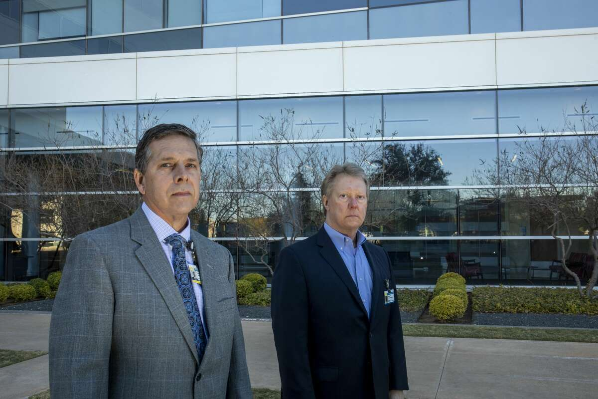 Dr. Larry Wilson, Midland Health chief medical officer, and President and CEO Russell Meyers stand outside Midland Memorial Hospital on Dec. 7.