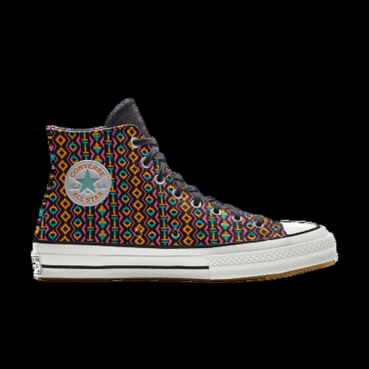 The high-top sneakers start at $115 and feature three customizable designs. There's a black base with a Fieesta-hued Spur logo on the body, a white canvas with