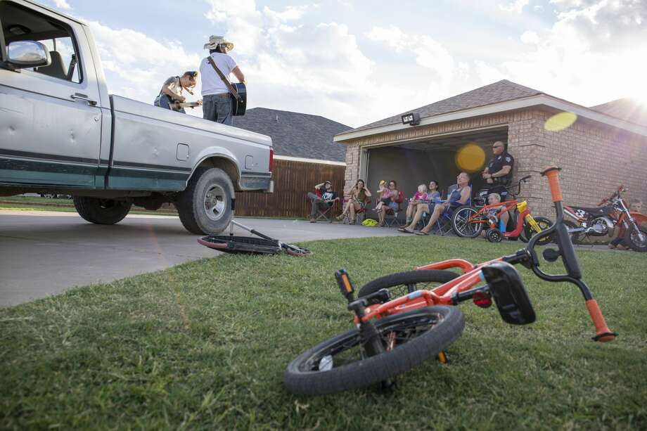 This photo reminds me of a summer spent social distancing. A local duo, Ash and Gabe Sing Country Gold -- Gabriel Lopez and Ash Pankey -- decided to host Truck-a-grams for households to provide entertainment while encouraging staying at home and social distancing during the pandemic. The duo play May 2 at the home of Richard McKee on Casper Court. Valerie Ontiveros saw Lopez post about the Truck-a-grams which she thought was a great idea for a Saturday night. Photo: Jacy Lewis/Jacy Lewis/Reporter-Telegram
