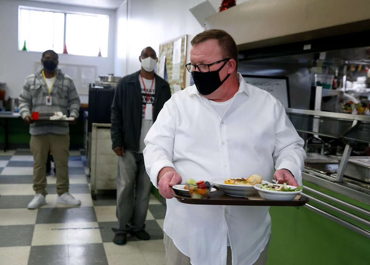 Shaween Sullivan has lunch in the dining room at the Salvation Army's Harbor Light Center in San Francisco, Calif. on Wednesday, Dec. 16, 2020.