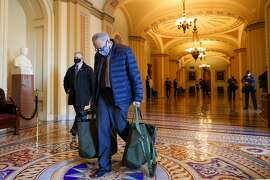 """WASHINGTON, DC - DECEMBER 29: Senate Minority Leader Chuck Schumer (D-NY) arrives on Capitol Hill on December 29, 2020 in Washington, DC. Senate Majority Leader Mitch McConnell (R-KY) said the Senate would """"begin a process"""" to consider larger stimulus checks for Americans from the proposed $600 to $2,000 on Wednesday.  (Photo by Tasos Katopodis/Getty Images)"""