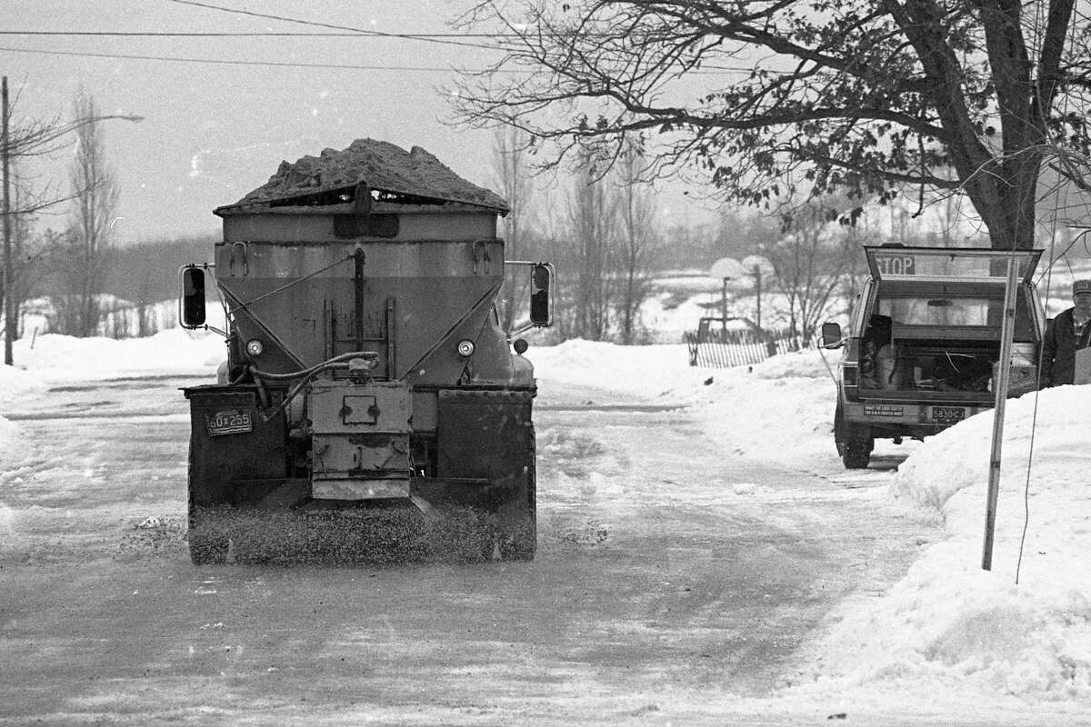 During Christmas week in 1980, city and county now plows were a constant sight as snow and ice was built up on area roads. This photo was taken for the Dec. 30, 1980 issue of the News Advocate. (Manistee County Historical Museum photo)