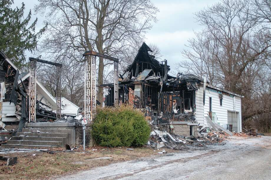 A Dec. 16 fire at 347 Sandusky St. caused just under $200,000 damage to the structure and additional damage to neighboring properties. Photo: Darren Iozia | Journal-Courier / Jacksonville Journal-Courier