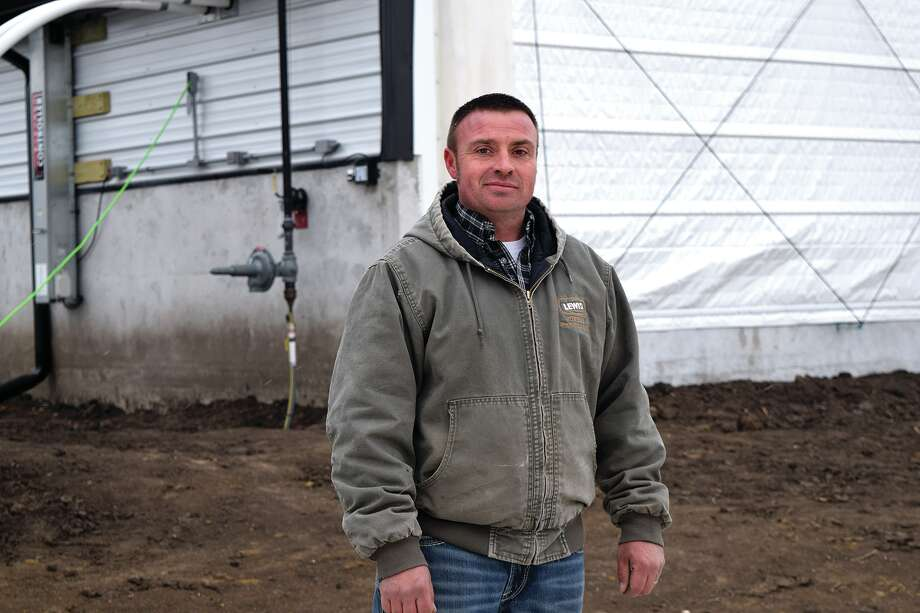 Jarrad Colwell stands in front of the hog barn he and his family helped Longhorn Construction build near Franklin. They will be giving tours of the facility Monday and Tuesday before the hogs arrive. Photo: Rochelle Eiselt | Journal-Courier
