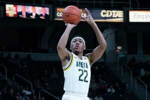 ALBANY, NY - FEBRUARY 16:  Siena Saints Guard Jalen Pickett (22) shoots a three point jump shot during the second half of the College Basketball game between the Manhattan Jaspers and the Siena Saints on February 16, 2020, at the Times Union Center in Albany, NY.