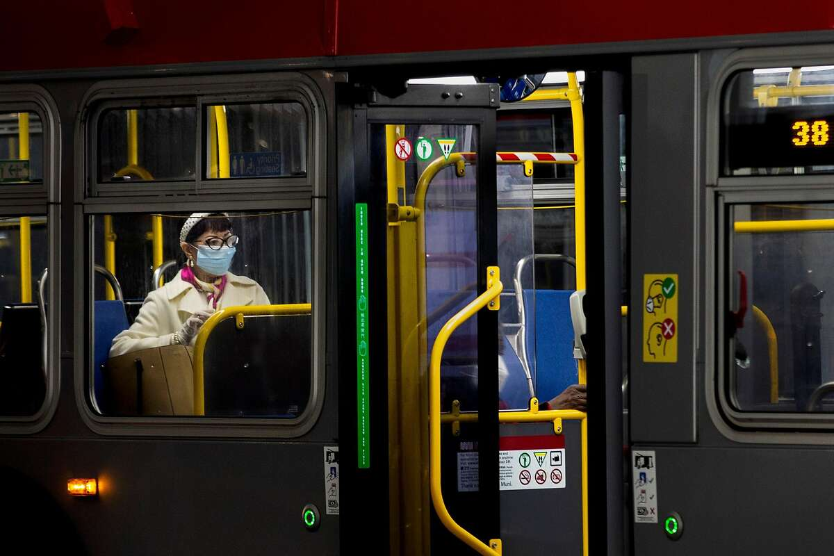 A muni passenger takes their seat in a nearly empty 38-Geary bus that departs from Salesforce Transit Center, Thursday, Dec. 24, 2020, in San Francisco, Calif. The coronavirus pandemic led to a decline in public transportation ridership.